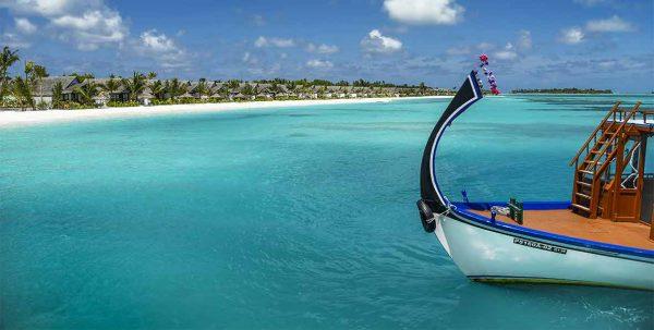 dhoni y playa en Ozen atmosphere