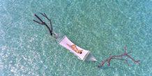 vista aerea mujer en hamaca, Sun Aqua Vilu Reef